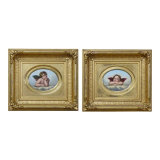 Pair of Porcelain Plaques After Raphael's Cherubs in the Sistine Madonna For Sale