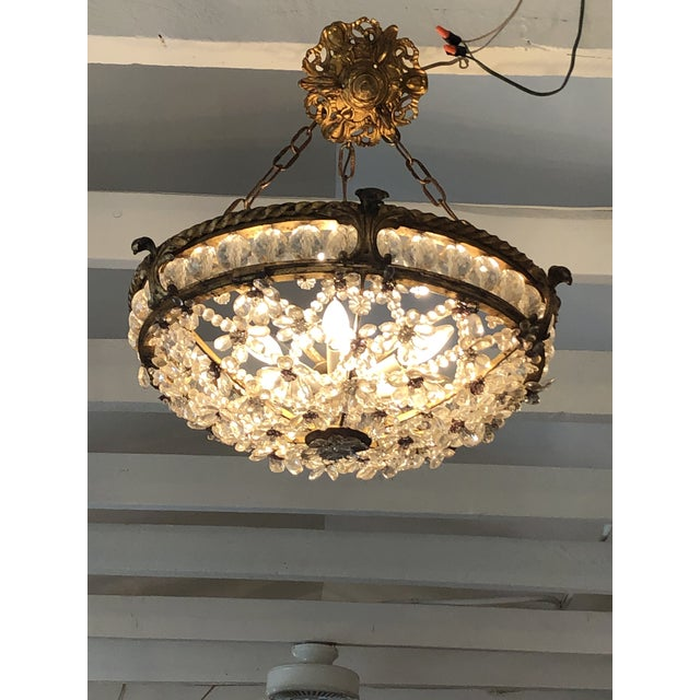 A magnificent large 19th century chandelier having dome shaped bronze body encrusted with gorgeous flower motif crystals,...