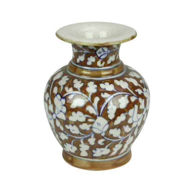 Jaipur ceramic vase hand-painted with floral and foliage motif. Finished with a glass glaze. Minor blemishes.