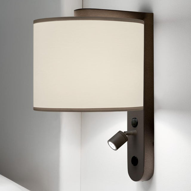 A penny bronze wall light with a separate LED. There are two switches: one for the main light and one for the LED reading...