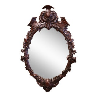 19th Century French Black Forest Carved Walnut and Beveled Glass Oval Mirror For Sale