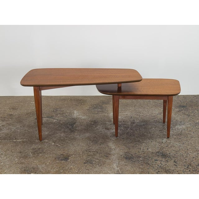 Sleek coffee table, design attributed to Bertha Schaefer for Singer and Sons. A classic design with Italian influence in...