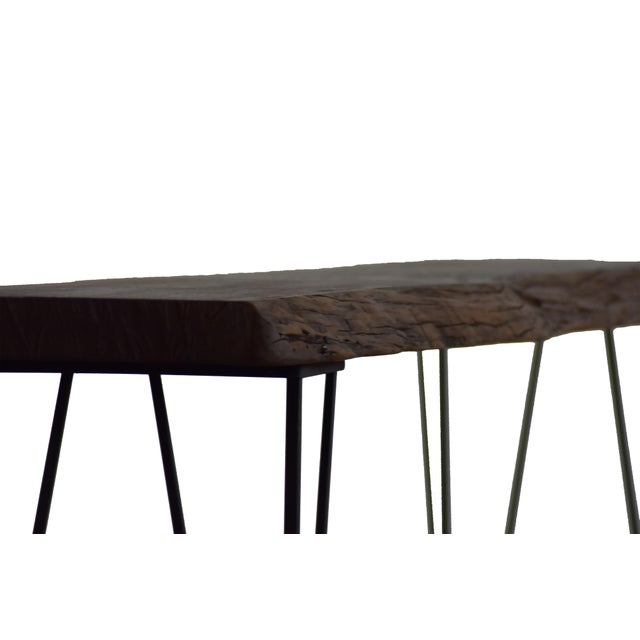 This one-of-a-kind console table is a hit almost anywhere! The stunning live edge provides a unique character creating the...