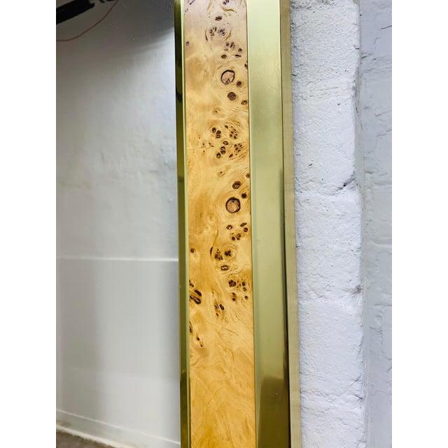 Mid Century Modern Brass and Burl Wood Mirror. Nice burl wood grain with brass trim.