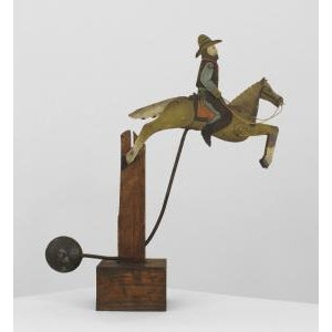 American Country (19/20th Cent) Folk Art toy of a painted and decorated metal cowboy on a horse with moving parts mounted...
