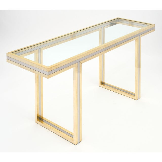Romeo Rega signed console table made of brass and chromed steel. We love the square sectioned lines and the strong...
