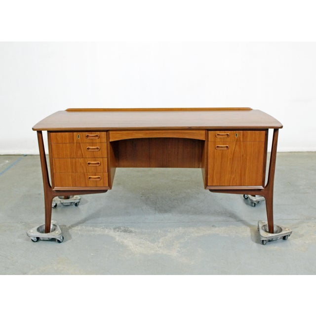 Offered is a completely restored Danish modern desk by Sven Aage Madsen. Has been professionally refinished. This piece is...