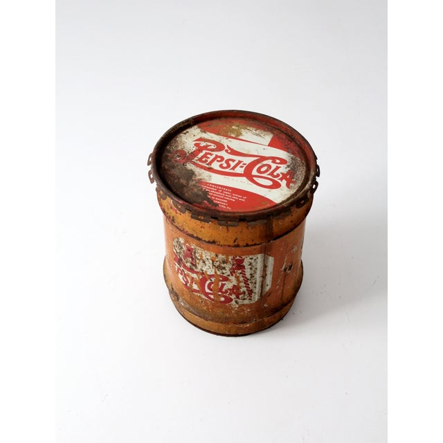 Vintage circa 1940s, well-worn Pepsi-Cola concentrate can. The 10 gallon metal drum has worn down to reveal an orange tone...
