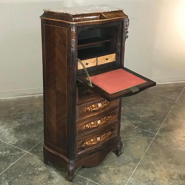 19th Century French Parisienne Rosewood Marble Top Drop-Front Secretary is an example of Napoleon III Period artistry that...