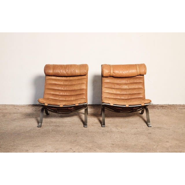 A stunning pair of Arne Norell Ari Chairs, Norell Mobler, Sweden, 1970s. In rarely seen cognac / tan buffalo leather. In...