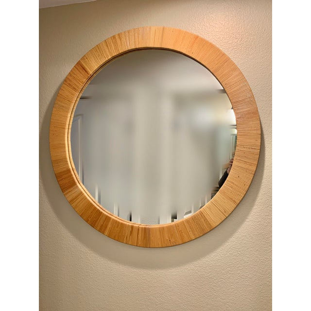 Now available for purchase this gorgeous well scaled Bielecky Brothers rattan wall mirror. It is in near perfect...
