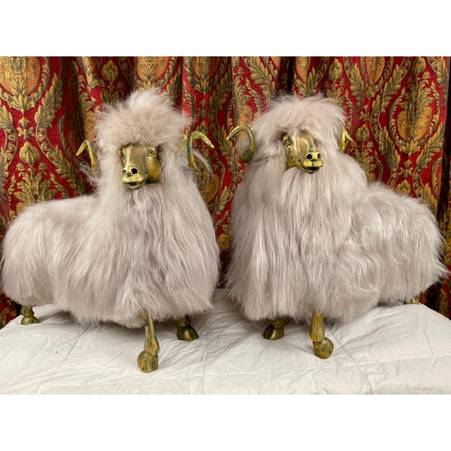 Striking pair of bronze sheep sculptures / ottomans with long platinum Icelandic sheep fur. Whimsical and playful, these...