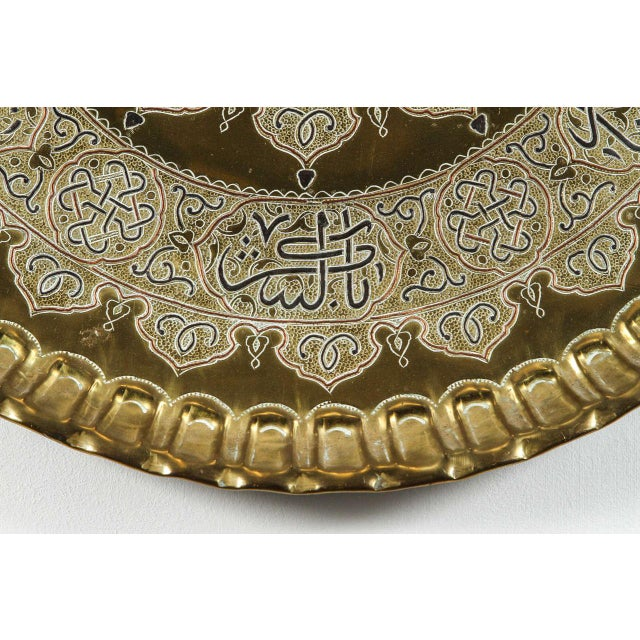 Large Middle Eastern brass platter in Mamluk revival style, Islamic inlay metal charger artwork. Very decorative large...