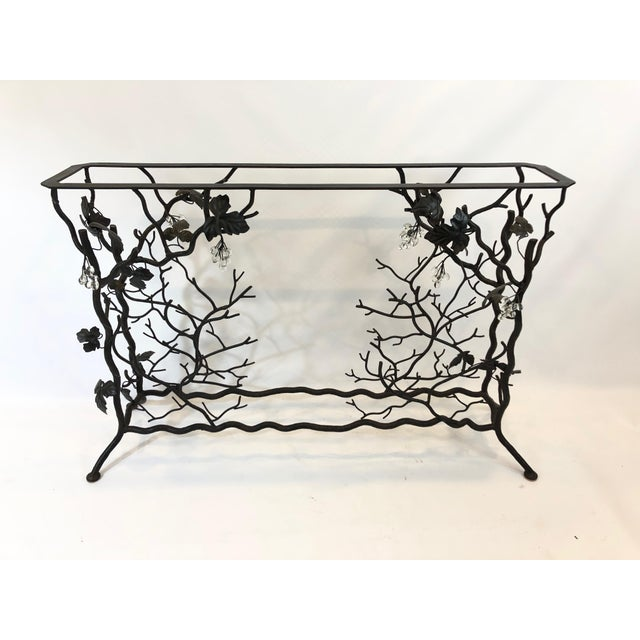 Elegant sculptural hand forged iron console table and functional wine rack having a grapevine motife with leaves, branches...