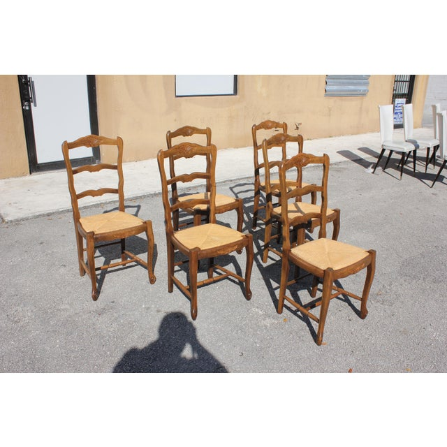 Set of six French Country chairs Solid walnut Circa 1910s ,Original rush seats are in good condition ,Cabriole legs ending...