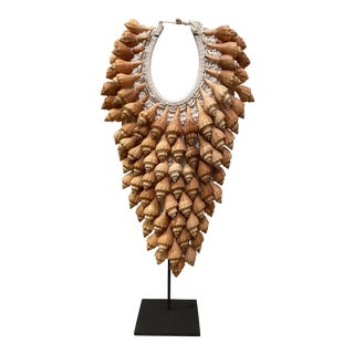 Asian Style Seashell Necklace on Stand For Sale