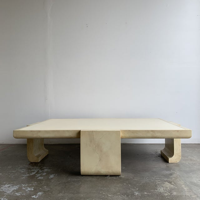 Monumental coffee table in a great vanilla off white. Item was executed in a solid wood frame and finished in high polish...