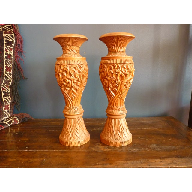 A gorgeous pair of large wooden carved vases. Each is slightly different. Notice the fine details and lovely wood grain....