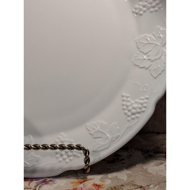 "A 14"" Indiana milk glass serving plate/platter with grapevine pattern aroung knotched edges. Also in grape pattern a..."