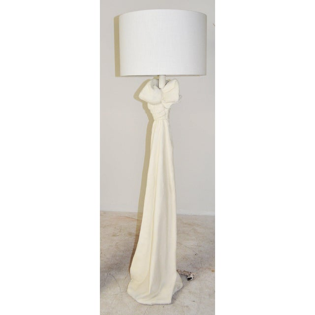 A pair sculptural John Dickinson style plaster of Paris lamps. Plaster 'fabric' drape with tied bow at the top. They have...