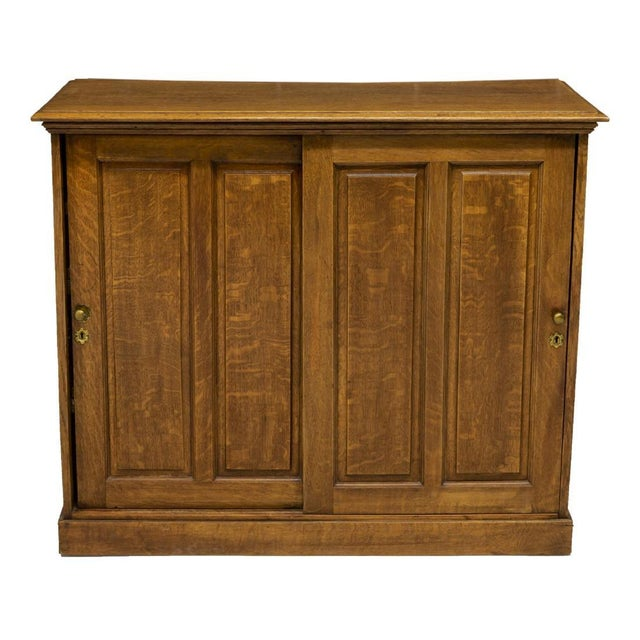 Classic clean lines with light yet rich color tone, this American golden oak cabinet is from the early 20th c. The piece...
