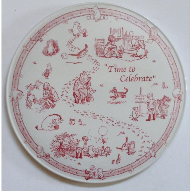 Likely intended as a birthday cake plate for a girl, this charming plate has all the Pooh characters on top fashioned by...
