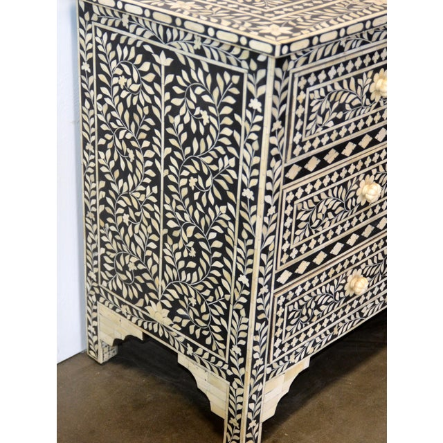 White bone and ebony inlay makes for a very intricate and beautiful piece of furniture.