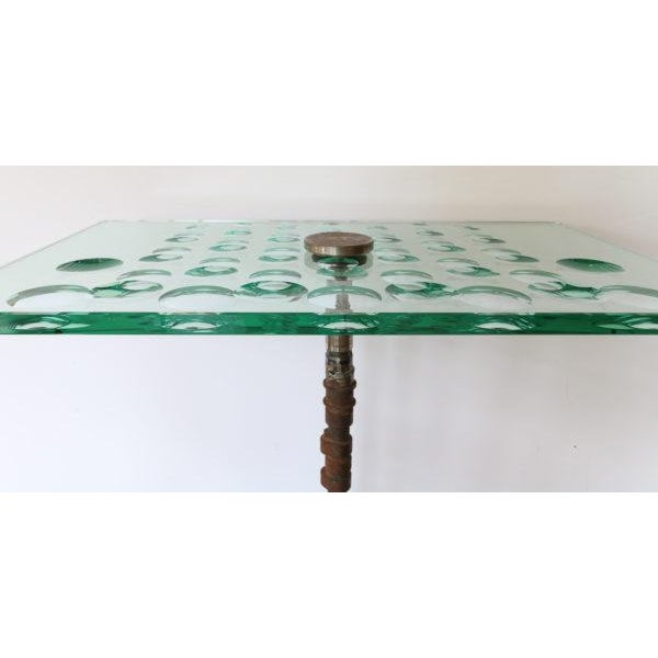 """Feliciano Béjar """"Magiscopo"""" table made with used gear and engineering parts."""