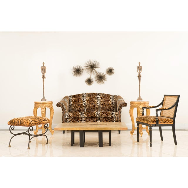 English Victorian style modern loveseat with camel back and upholstered in leopard print velvet.