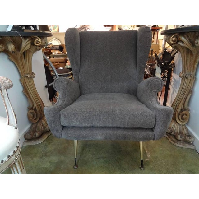 Unique and comfortable pair of Mid-Century Italian Marco Zanuso style lounge/club chairs/bergeres with polished brass...