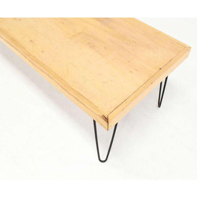 Very nice mid-century modern look heavy solid birch top hair pin legs coffee table.