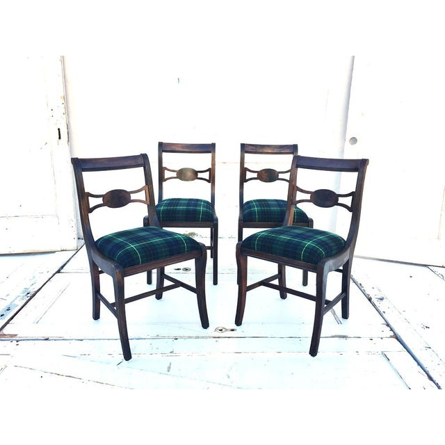 We are in love with this set of four solid wood dining chairs! Rustic, with wool plaid upholstered seats, they would be...