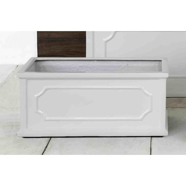A window box of Fiber Clay Composite in a glossy white finish. Available in multiple sizes or as a set.