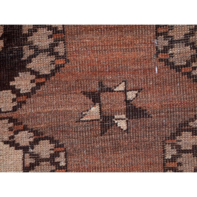 """Antique Afaghan Ersari rug with repeating """"Elephant foot"""" pattern. The rug is in chocolate brown, beige and peach (..."""