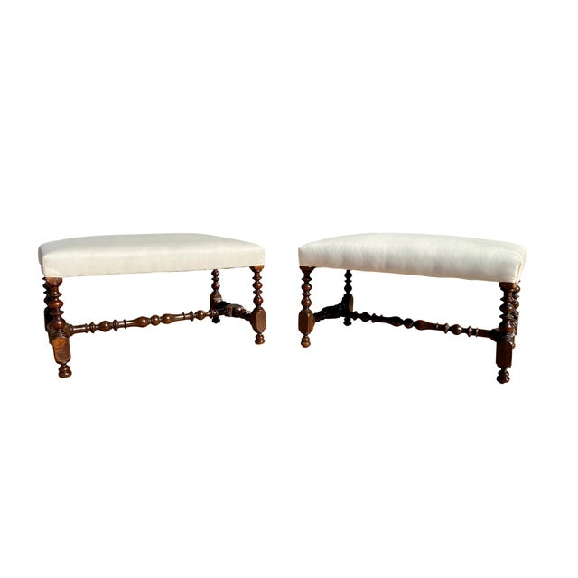 Each with rectangular newly upholstered muslin seats and raised on turned legs and stretchers.