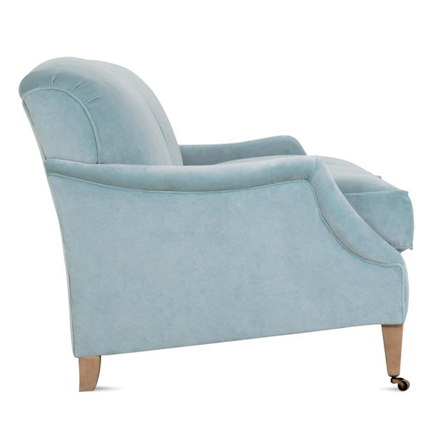 Two seat cushion sofa with a serpentine back and tapered legs. Front legs have brass casters. Spot clean as needed.