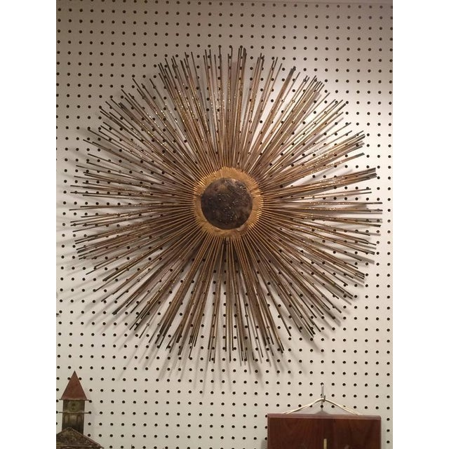 Mid Century Brutalist Starburst Wall Sculpture. Iconic design ideal for that living room wall or bedroom accent piece. In...
