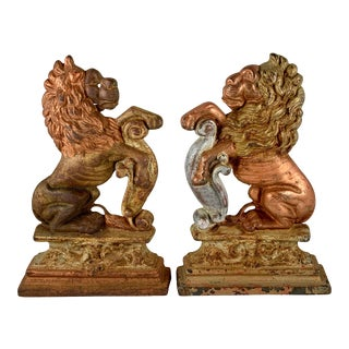 Gilded Cast Iron Heraldic Lion Doorstops or Bookends, a Pair For Sale