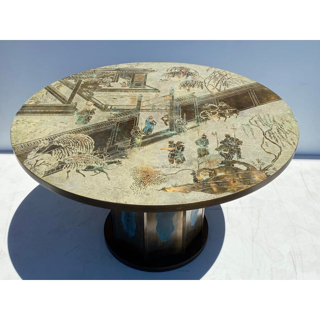 "Philip and Kelvin LaVerne ""Chan"" dining/center/game table. 47.25"" diameter by 29"" high. The base is 23"" diameter."