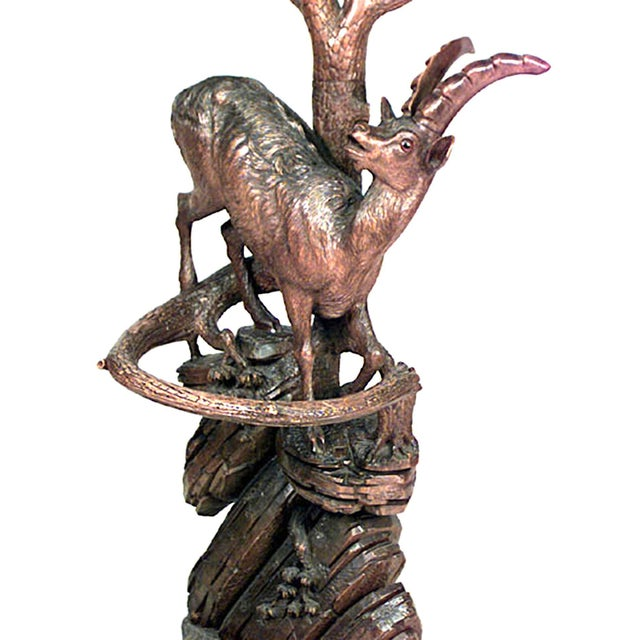 Rustic black forest (19th century) carved walnut or hatrack umbrella stand with deer figure on base and mirror on the...