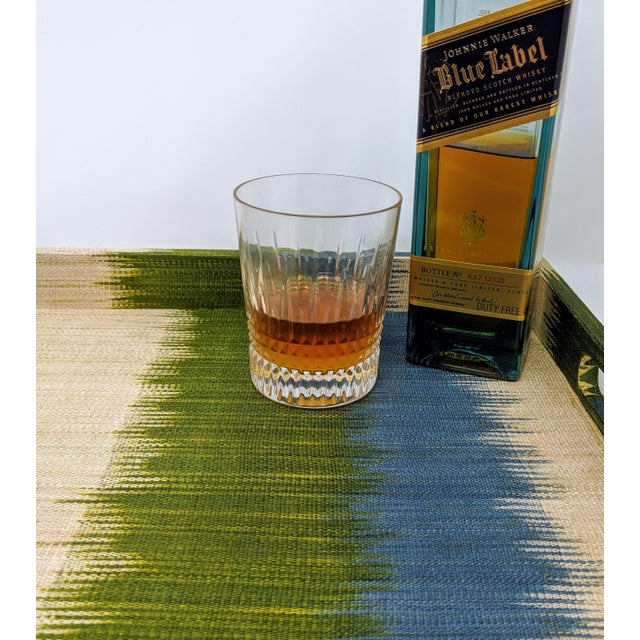 The material covering this Made Good tray is woven by a tribe in the Philippines, and naturally dyed with vegetation,...