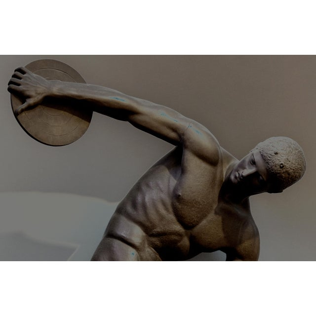 Lifesize bronze figure of an Olympic discus thrower from antiquity. Archival Inkjet Print (Matte). 90cm x 130cm (80cm x...