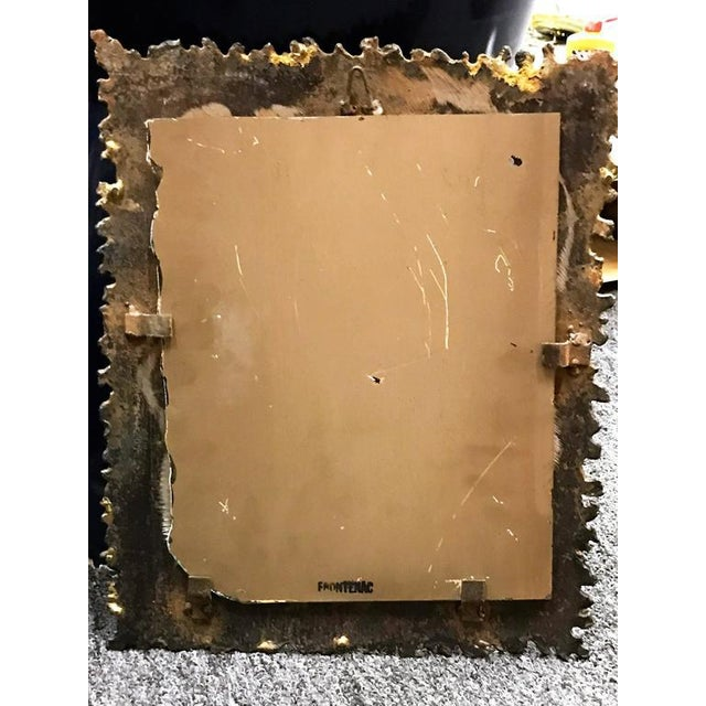 Great bronze and gold flared torch cut metal mirror.