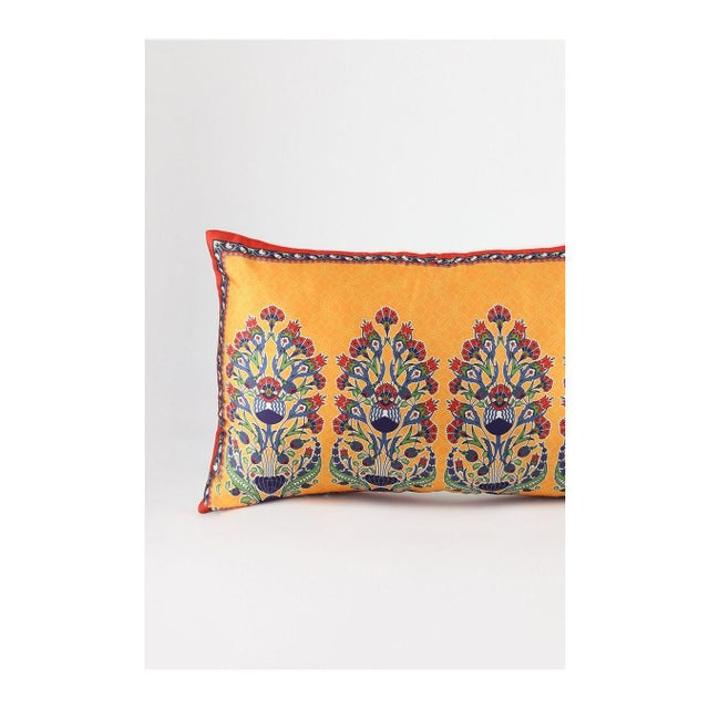 Beautiful Vibrant Silk Bohemian Orange Blue pillow with a floral design. The front panel is Silk and the back panel is...