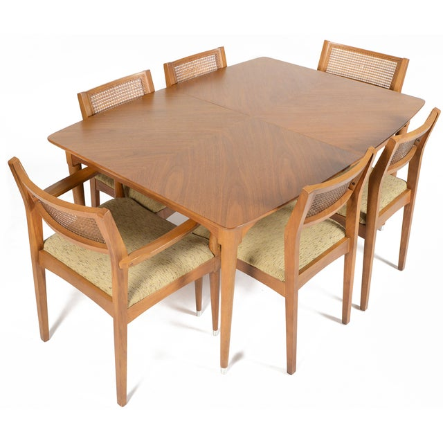 Wonderfully preserved, this stately B.P. John American Mid-Century Correlaire Collection dining set in walnut is a...