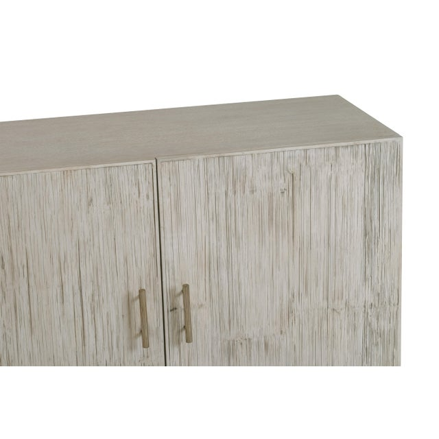 An elegant cabinet from the Century Furniture Bamboo Collection. Crafted of beech solids and oak veneer with crushed...