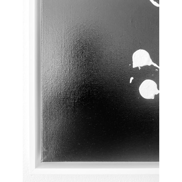 White Slant Splatter is an original painting by Axel Abbott. The piece is black and white, finished in a white floating...