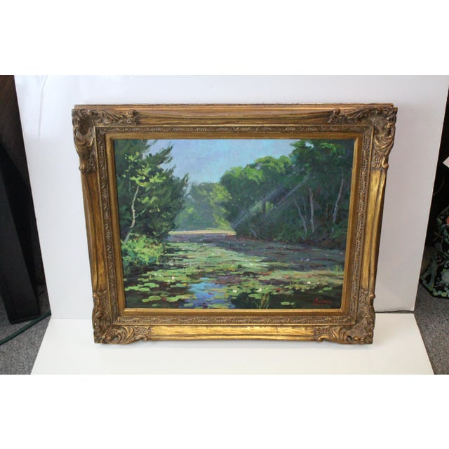 Oil on canvas by Foster Caddell of a marsh in Spring with vibrantly green flora and lily pads.