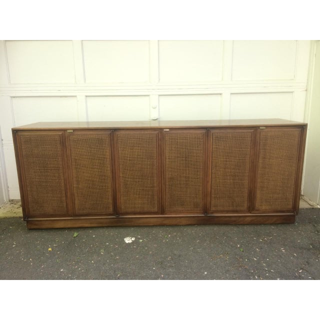 Sleek credenza / buffet / sideboard / dresser by the Founders furniture company. Elegant little rectangular brass handles....