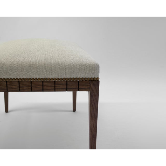 The Dubois bench by LF Upholstery is a hand-carved bench serving as an example of craftsmanship at its best. Available in...